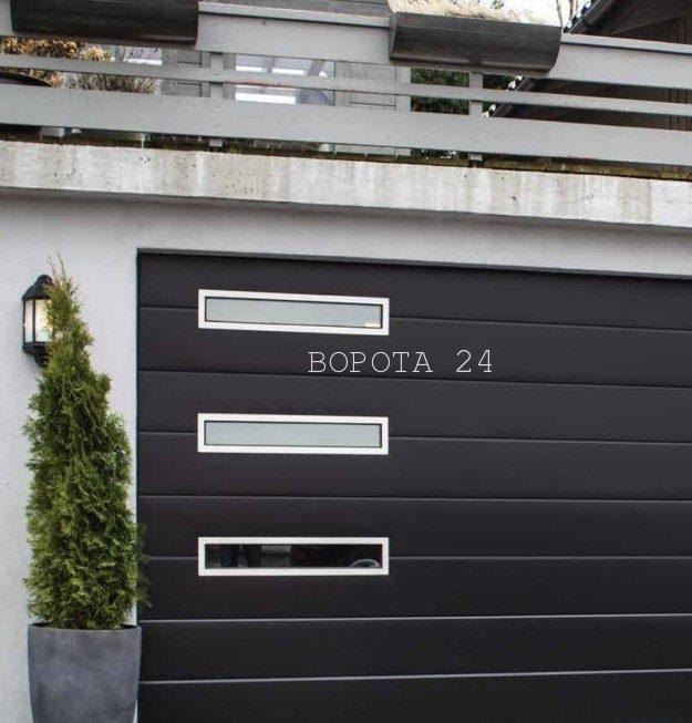 Дизайнерские теплые ворота в гараж